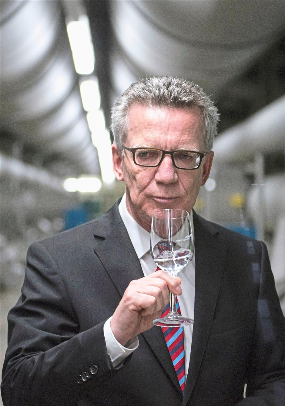 German Interior Minister Thomas de Maiziere holds a glass of tap water during a visit to Berlin water supplier Berliner Wasserbetriebe in August. Germany, along with countries like Austria, Belgium, China, Denmark, Japan and Hungary, do not add fluoride to their water supply. Photo: Reuters