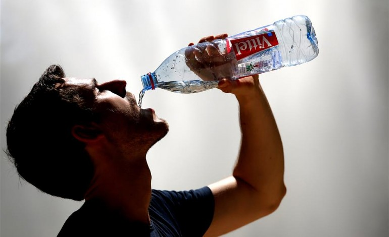 A man drinking water on a hot summer day in Brussels, Belgium. Belgium, along with countries like Austria, China, Denmark, Japan and Hungary, do not add fluoride to their water supply. Photo: Reuters HEALTH
